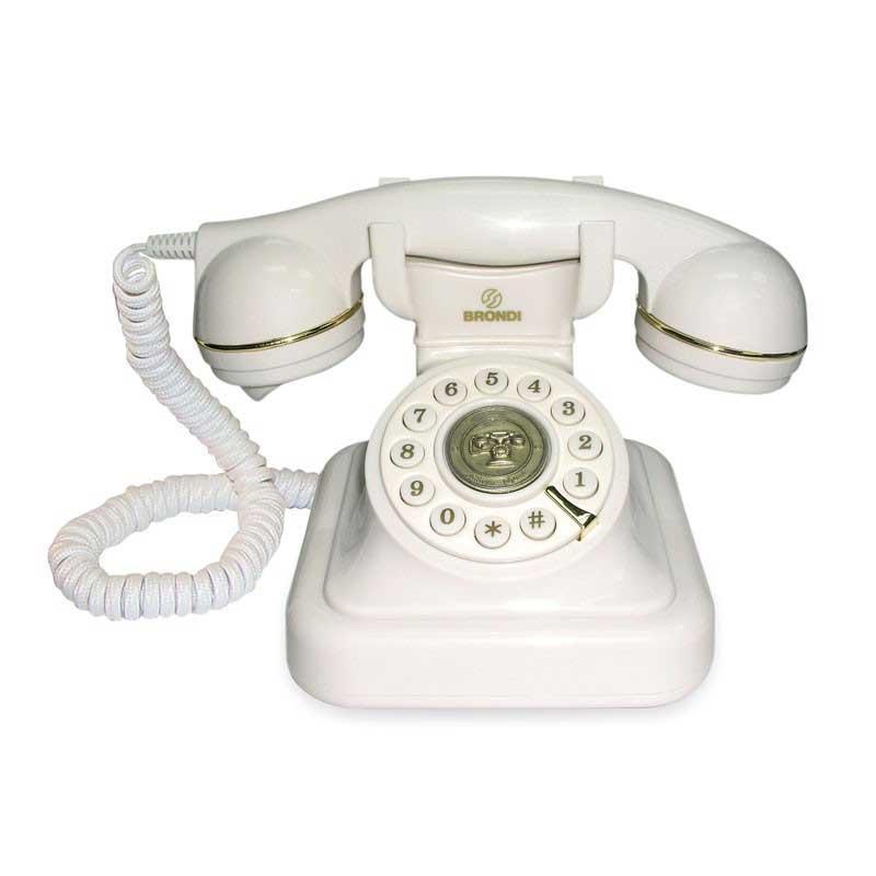 Telefono Brondi Vintage 20 - Blanco - Los teléfonos Vintage 20 blanco de Brondi le darán un toque retro al interior de tu casa u oficina al tiempo que aporta calidad a sus llamadas. El teléfono Vintage 20 memoriza el último número marcado para efectuar rellamada y le permite ajustar el volumen del tono de llamada timbre. Discado por tono / pulso. Diseño Vintage con bordes en símil de oro y trama de cables. ¡ Viaje en el tiempo con el Vintage 20 !. - Medidas ancho x profundo x alto: 14,5x14,5x16 cm.