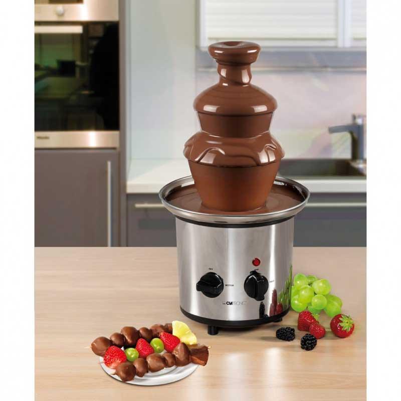 Fuente Chocolate Clatronic SKB3248 - Bomann SKB1282 - Fuente para chocolate caliente con altura ajustable para un flujo perfecto del chocolate. Maquina fondue de derretir chocolate fabricada en Acero inoxidable. Motor y termostato con funcionamiento por separado. Base antideslizante. Capacidad de 1 kg de chocolate. - Dimensiones ancho x alto: 23 x 41 cm. - Alimentación eléctrica : 230v, 50hz. - Potencia: 170w. - Equivalente a modelo: Bomann SKB 1282