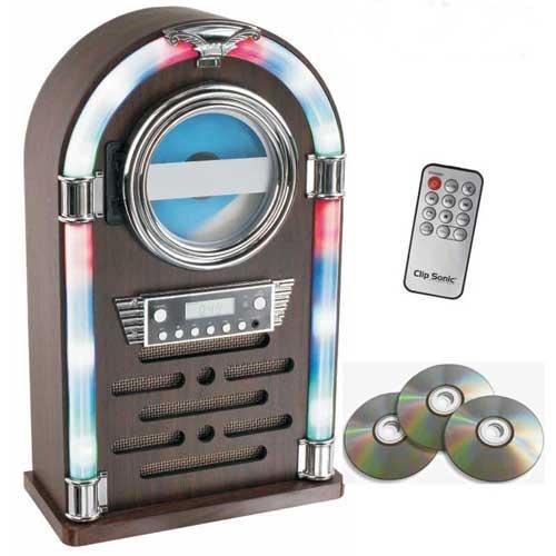 Jukebox compatible Bluetooth® Clipsonic TES195 - CD/CD-R/CD-RW/radio FM - Ahora tienes la oportunidad de disfrutar de la música en una original gramola con esta atractiva Jukebox de Clipsonic. Un diseño único con acabado en madera y luces al estilo de los años 60, que incorpora lector de CD / CD-R / CD-RW, radio FM. Toda la música que tengas en otros dispositivos Bluetooth® podrás reproducirla fácilmente en la Jukebox y escucharla con calidad , a través de sus altavoces. También podrás transportarla con comodidad gracias a su tamaño compacto y controlar fácilmente la música que quieres escuchar con su mando a distancia. Cumple por fin el sueño de tener tu propia Jukebox y disfruta de un diseño atemporal, que nunca pasará de moda. ( Ver DETALLES )