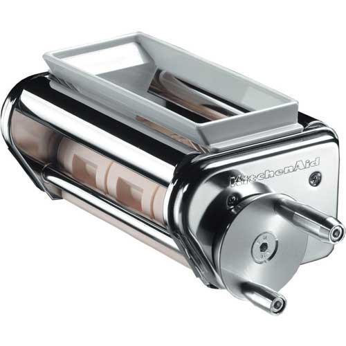 Maquina de Raviolis accesorio Kitchenaid 5KRAV - Fácil accionamiento manual que posibilita un relleno y sellado preciso de los raviolis. El accesorio para raviolis de Kitchenaid 5krav está fabricado en acero inoxidable 18-10 e incluye recipiente contenedor, cepillo para limpieza y cuchara para rellenar. Compatible con todos los robots de cocina Kitchenaid: Ultra Power, Classic, Heavy Duty y Artisan. Complementa el juego del rodillo para láminas de pasta y cuchillas KPRA. Para rellenar su pasta favorita con sus rellenos preferidos. Fabricado de metal cromado muy resistente.  Con este accesorio la amasadora batidora mezcladora Kitchenaid se transforma en un robot de cocina profesional, el perfecto ayudante de su cocina. - Referencia anterior: KRAV -( ENVÍO GRATIS ).