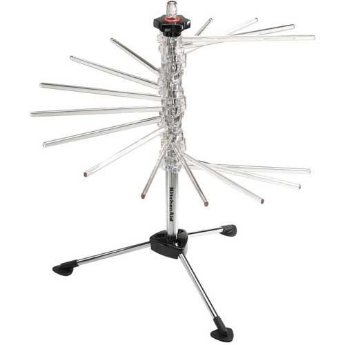 Rejilla para secado de pasta accesorio Kitchenaid 5KPDR - Rejilla para secado de pasta fresca accesorio Kitchenaid 5KPDR CLR. – Válido para robots modelos 5K45SS, 5KSM150PS-156, 5KPM5-50, 5KSM7580X, 5KSM7591X y 5KSM7990X. – Despliegue la base y, a continuación, los brazos del aparato para formar una espiral de más de 3 metros - de 16 brazos de 20,32 cm cada uno - de espacio total de rejilla de secado. Utilice la varita que viene en el pie central para manipular los tagliatelle o los espaguetis a medida que salen de la máquina para pasta. Entonces coloque la pasta fresca en la rejilla para secado. La rejilla no ocupa espacio de trabajo y permite un secado rápido y uniforme. – Color: pie negro y brazos transparentes.