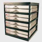 Soporte Encuadernadora UNIBIND - La mesa de trabajo de Unibind està especialmente diseñado para colocar las máquinas encuadernadoras. Dispone de varios compartimentos para almacenar sus carpetas, listas para su utilización. La línea simple y práctica es apropiada en cada interior.
